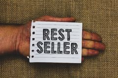 Handwriting text writing Rest Seller. Concept meaning one feature or the perceived benefit good which makes it unique Man hand hol. Ding piece notebook paper stock images