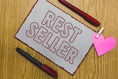 Handwriting text writing Rest Seller. Concept meaning one feature or the perceived benefit good which makes it unique Piece paper. Clothespin holding heart royalty free stock image
