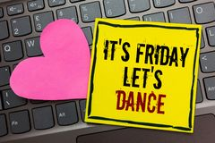 Handwriting text writing It s is Friday Let s is Dance. Concept meaning Celebrate starting the weekend Go party Disco Music Writte. N on black bordered yellow royalty free stock photo