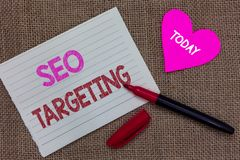 Handwriting text writing Seo Targeting. Concept meaning Specific Keywords for Location Landing Page Top Domain Piece notebook pape. R heart jute background open stock images