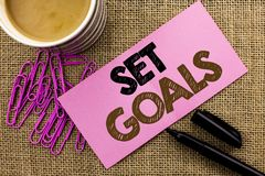 Handwriting text writing Set Goals. Concept meaning Target Planning Vision Dreams Goal Idea Aim Target Motivation written on Pink. Handwriting text writing Set Royalty Free Stock Image