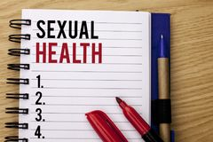 Handwriting text writing Sexual Health. Concept meaning STD prevention Use Protection Healthy Habits Sex Care written on Notebook. Handwriting text writing royalty free stock photos