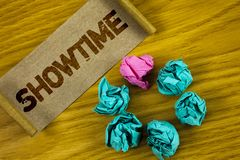 Handwriting text writing Showtime. Concept meaning Time a Play Film Concert Performance Event is scheduled to start written on Fol. Handwriting text writing Stock Image
