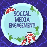 Handwriting text writing Social Media Engagement. Concept meaning Communicating in an online community platforms Cutouts of Sliced. Lime Wedge and Herb Leaves stock illustration