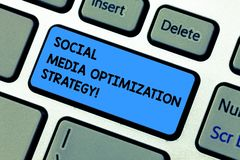 Handwriting text writing Social Media Optimization Strategy. Concept meaning SEO Advertising Marketing strategies. Keyboard key Intention to create computer stock photography