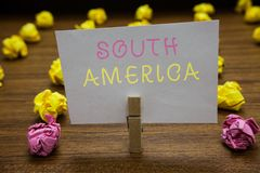 Handwriting text writing South America. Concept meaning Continent in Western Hemisphere Latinos known for Carnivals Clothespin hol. Ding white paper note royalty free stock photography