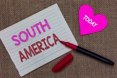 Handwriting text writing South America. Concept meaning Continent in Western Hemisphere Latinos known for Carnivals Piece notebook. Paper heart jute background royalty free stock image