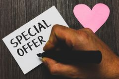 Handwriting text writing Special Offer. Concept meaning Selling at a lower or discounted price Bargain with Freebies Man hand hold. Ing marker white paper royalty free stock image