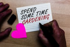 Handwriting text writing Spend Some Time Gardening. Concept meaning Relax planting flowers fruits vegetables Natural Written on no. Tepad hand hold marker with stock photos