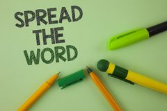 Handwriting text writing Spread The Word. Concept meaning Run advertisements to increase store sales many fold written on Plain Gr. Handwriting text writing royalty free stock images