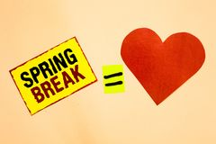 Handwriting text writing Spring Break. Concept meaning Vacation period at school and universities during spring Yellow piece paper. Reminder equal sign red royalty free stock photo
