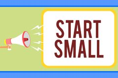 Handwriting text writing Start Small. Concept meaning Small medium enterprises start up Business entrepreneurship Man holding mega. Phone loudspeaker speech royalty free illustration