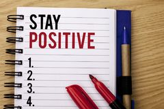 Handwriting text writing Stay Positive. Concept meaning Be Optimistic Motivated Good Attitude Inspired Hopeful written on Notebook. Handwriting text writing Stay Stock Photo