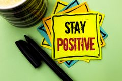 Handwriting text writing Stay Positive. Concept meaning Be Optimistic Motivated Good Attitude Inspired Hopeful written on Sticky N. Handwriting text writing Stay Stock Image