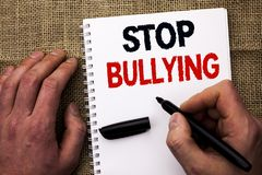 Handwriting text writing Stop Bullying. Concept meaning Do not continue Abuse Harassment Aggression Assault Scaring written by Man. Holding Marker Notebook Book Royalty Free Stock Photos