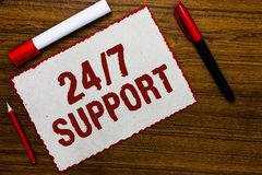 Handwriting text writing 24 7 Support. Concept meaning Giving assistance to service whole day and night No downtime White paper re. D borders markers wooden royalty free stock photo