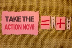 Handwriting text writing Take The Action Now Motivational Call. Concept meaning Act Start Promptly Immediate Instantly Jute sacks. Plus two paper clip equal stock image