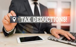 Free Handwriting Text Writing Tax Deductions. Concept Meaning Reduction Income That Is Able To Be Taxed Of Expenses Male Royalty Free Stock Photos - 163844488