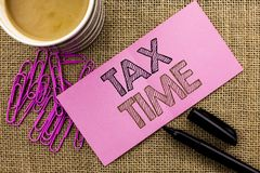Handwriting text writing Tax Time. Concept meaning Taxation Deadline Finance Pay Accounting Payment Income Revenue written on Pink. Handwriting text writing Tax Royalty Free Stock Images