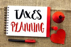 Handwriting text writing Taxes Planning. Concept meaning Financial Planification Taxation Business Payments Prepared written on No. Handwriting text writing Stock Photo