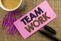 Handwriting text writing Team Work. Concept meaning Cooperation Together Group Work Achievement Unity Collaboration written on Pin. Handwriting text writing Team Royalty Free Stock Photo