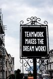 Handwriting text writing Teamwork Makes The Dream Work Call. Concept meaning Camaraderie helps achieve success Vintage black board. White letters words cloudy Stock Photography