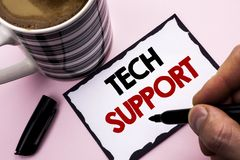 Handwriting text writing Tech Support. Concept meaning Help given by technician Online or Call Center Customer Service written by. Man Sticky Note paper holding Stock Photography