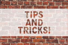 Handwriting text writing Tips And Tricks. Concept meaning Steps Life hacks Handy advice Recommendations Skills Brick. Wall art like Graffiti motivational call royalty free stock photography
