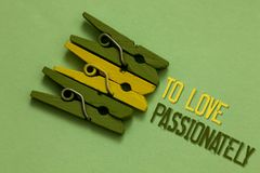Handwriting text writing To Love Passionately. Concept meaning Strong feeling for someone or something else Affection Olive ground. Laid on paperclip in front Royalty Free Stock Image
