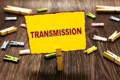Handwriting text writing Transmission. Concept meaning Automobile engine part High voltage power electrical wires. Clothespin holding yellow paper note several royalty free stock image