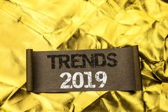 Handwriting text writing Trends 2019. Concept meaning Current Movement Latest Branding New Concept Prediction written on Cardboard. Handwriting text writing royalty free stock photos