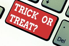 Handwriting text writing Trick Or Treat. Concept meaning Halloween tradition consisting in asking for sweets Keyboard key stock photo