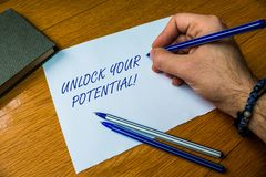 Handwriting text writing Unlock Your Potential. Concept meaning release possibilities Education and good training is key. Handwriting text writing Unlock Your stock image