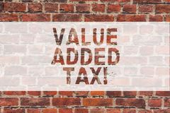 Handwriting text writing Value Added Tax. Concept meaning Amount of money added to cover production and distribution. Brick Wall art like Graffiti motivational royalty free stock photos