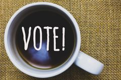 Handwriting text writing Vote Motivational Call. Concept meaning Formalized decision on important matters electing Mug coffee thou royalty free stock photography