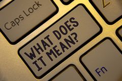 Handwriting text writing What Does It Mean Question. Concept meaning Confusion Curiosity Questioning Inquire Golden keyboard with. Jet gray button presents royalty free stock photos