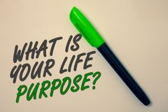 Handwriting text writing What Is Your Life Purpose Question. Concept meaning Personal Determination Aims Achieve Goal Ideas messag. E beige background green pen stock photo
