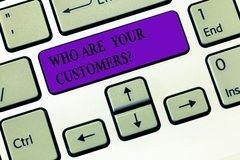 Handwriting text writing Who Are Your Customersquestion. Concept meaning Know your leads clients Business. Analysisagement Keyboard key Intention to create royalty free stock image