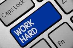 Handwriting text writing Work Hard. Concept meaning Laboring that puts effort into doing and completing tasks Keyboard blue key In. Tention create computer royalty free stock photo