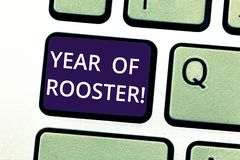 Handwriting text writing Year Of Rooster. Concept meaning Chinese horoscope zodiac sign China traditional celebration. Keyboard key Intention to create computer stock photos