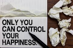 Handwriting text writing Only You Can Control Your Happiness.. Concept meaning Personal Self-motivation inspiration Marker over no. Tebook crumpled papers ripped stock image