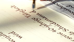Handwriting. A text is written with a pen and ink stock footage