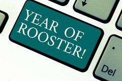 Handwriting text Year Of Rooster. Concept meaning Chinese horoscope zodiac sign China traditional celebration Keyboard. Key Intention to create computer message royalty free stock image