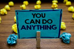 Handwriting text You Can Do Anything. Concept meaning Motivation for doing something Believe in yourself Blurry wooden stock photos