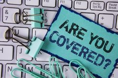 Handwriting text Are You Covered Question. Concept meaning Health insurance coverage disaster recovery written on Sticky Note pape. Handwriting text Are You Royalty Free Stock Photos