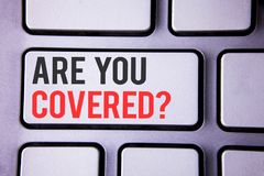 Handwriting text Are You Covered Question. Concept meaning Health insurance coverage disaster recovery written on white keyboard k. Handwriting text Are You Stock Photos