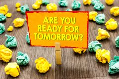 Handwriting text Are You Ready For Tomorrow question. Concept meaning Preparation to the future Motivation Paperclip hold written. Yellow page colorful paper stock image