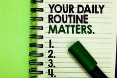 Handwriting text Your Daily Routine Matters. Concept meaning Have good habits to live a healthy life Written letters and. Numbers on notepad laid green marker stock photography