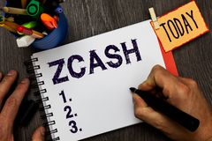 Handwriting text Zcash. Concept meaning cryptocurrency with decentralized blockchain that provides anonymity Man holding. Marker notebook clothespin hold stock images