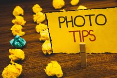 Handwriting text Photo Tips. Concept meaning Suggestions to take good pictures Advices for great photosgraphyClothespin holding Ye. Handwriting texts Photo Tips royalty free stock images
